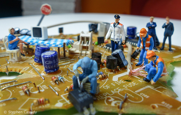miniature builders on motherboard